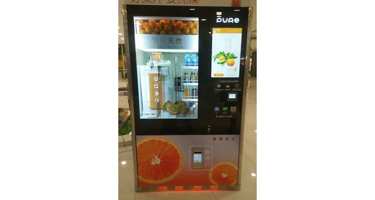 The Pure Juice vending machine features a display and a touch screen
