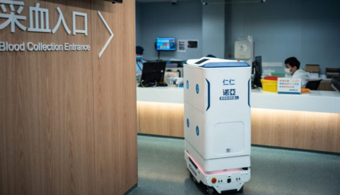 A mobile robot delivers medicine and meals to patients in healthcare facilities.