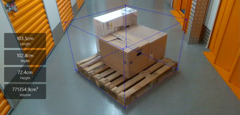 Object detection calculates dimensions for optimal placement of boxes stacked on a pallet.
