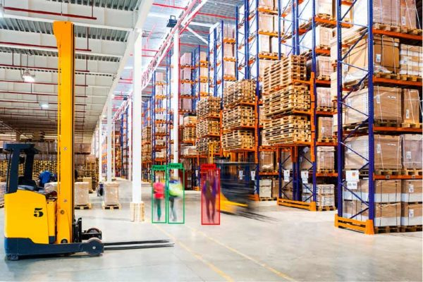 Large warehouse with 3 people highlighted to show CV in action.